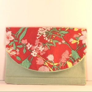 Red and musk green fabric clutch